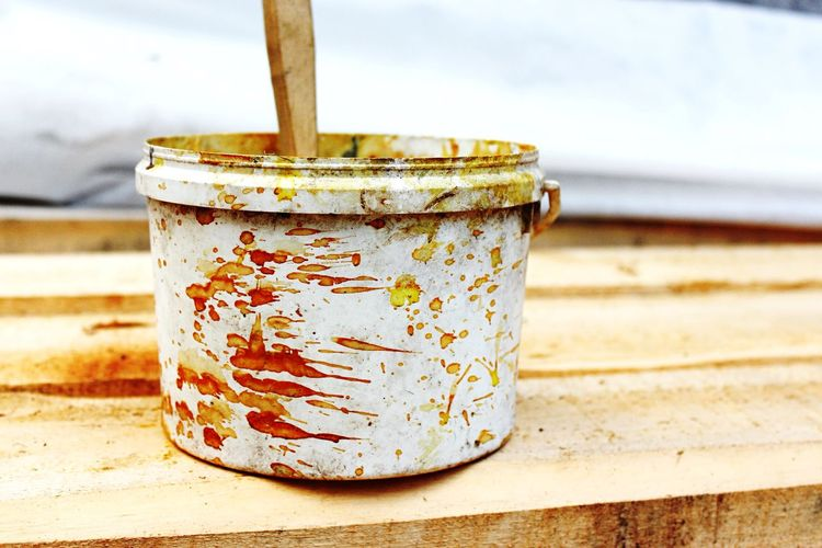 Close-Up Of Dirty Paint Can