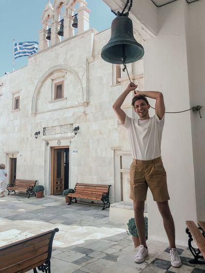 Portrait of man ringing bell