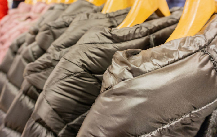 Winter fashion down jackets on a clothes rack Autumn Autumn Jacket Bottom Plumage Breathable Fashion Fluff Feather Geese Thermal Insulation Thermo-insulating Transition Jacket Winter Accessories Down Down Feather Down Jacket Downy Feather Jacket Structures Warm Waterproof Weatherproof