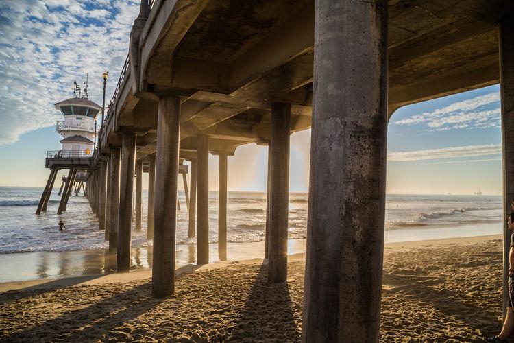 Below view of huntington beach pier in sea
