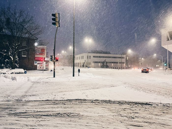 Snow covered street at night