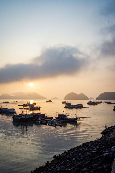 traveling Vietnam 2018 ASIA Travel Traveling Vietnam Beach Beauty In Nature Cloud - Sky Explore Fishing Boat Idyllic Marina Mode Of Transportation Moored Nature Nautical Vessel No People Outdoors Sailboat Scenics - Nature Sea Sky Sunset Tranquil Scene Tranquility Transportation Water Waterfront