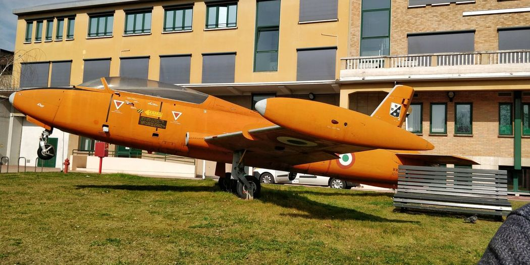 This is... Polimi Old Memories Outdoors Italy Orange Flight Fly Aeroplane Plane Milano Airplane Air Vehicle Architecture Building Exterior Built Structure Parking Stationary Land Vehicle Vehicle