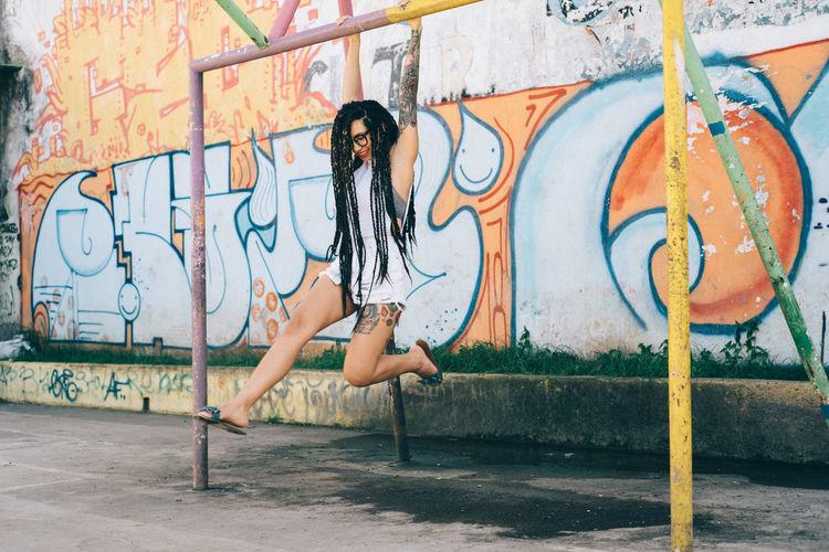 Woman with graffiti on wall