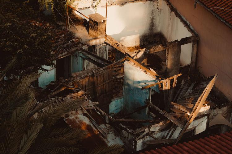 Abandoned building seen through broken window