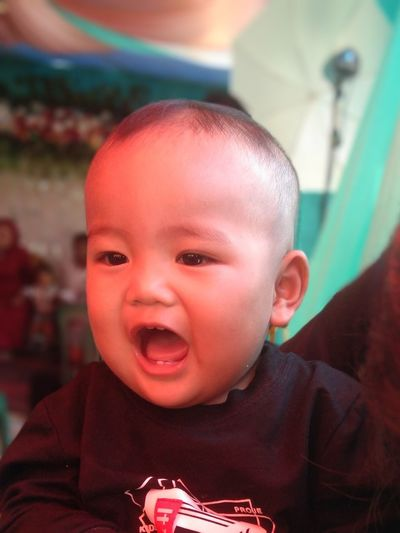 Cute baby boy with mouth open