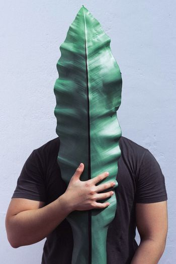 Man Standing Behind Leaf