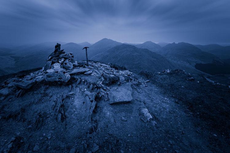 Axe On Beinn An Lochain Against Cloudy Sky
