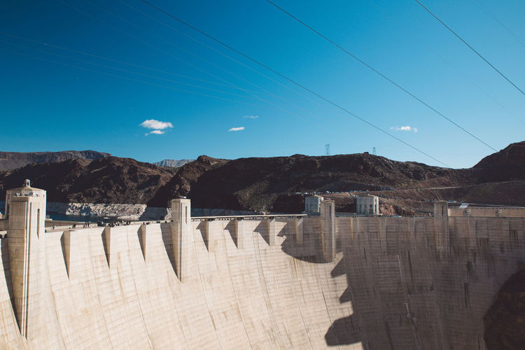 Scenic view of dam against sky