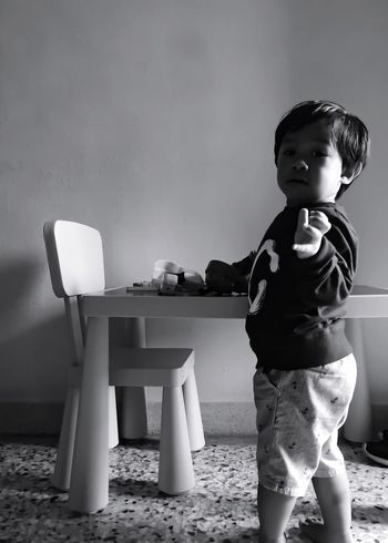 [ Kids Being Kids ] Light And Shadow Black And White Photography Black And White Collection  IPhoneography IPhone Photography Iphone6 B&w Table And Chair Ikea Table Chair And Table Boy Model One Boy Boy Playing
