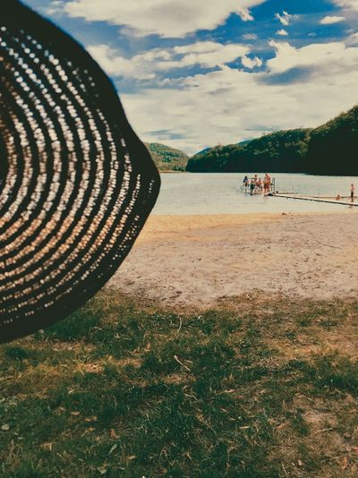 Sun hat at the beach Sun Hat Scenery Scenic Lake View Lake Water Sand Accessory Hat Sunlight Cloud - Sky Sky Nature Day Land Incidental People Water Beauty In Nature Outdoors Grass Beach Real People Group Of People Leisure Activity Pattern Scenics - Nature