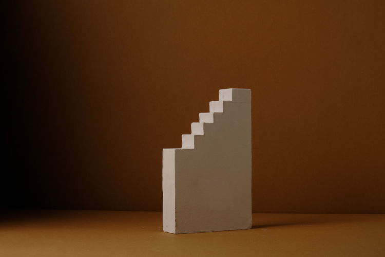 Stack of paper on table against wall