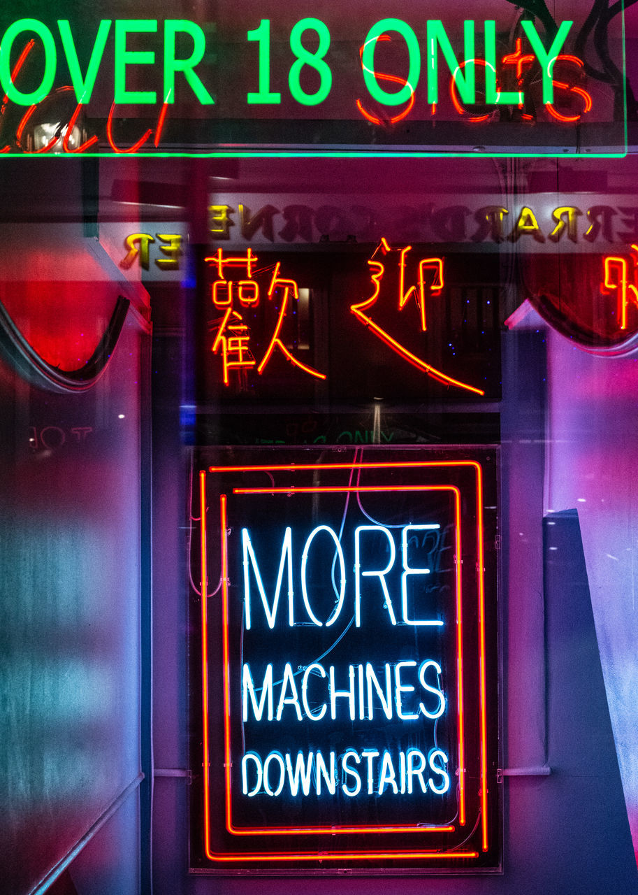 text, neon, western script, illuminated, communication, sign, commercial sign, no people, business, night, open sign, architecture, store, capital letter, advertisement, restaurant, information, food and drink, information sign, retail, outdoors, store sign, consumerism, nightlife