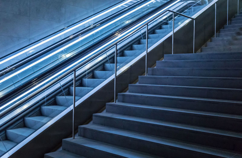 Architecture Escalator Underground Stairs Blue Stairway Day Staircase Neon Lights Steps Technology Railing Indoors  No People Hand Rail Moving Up In A Row Low Angle View Best Of Stairways Steps And Staircases The Architect - 2018 EyeEm Awards Capture Tomorrow Humanity Meets Technology 17.62°