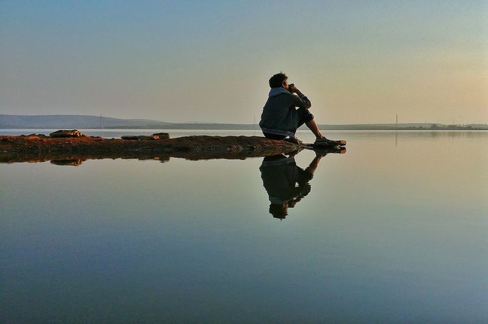 Horizon Over Water Sky Lonely Dreaming Reflection Water Sky Full Length Tranquility Waterfront Lake Nature One Person Only Men Beauty In Nature Outdoors Scenics Outdoor Pursuit