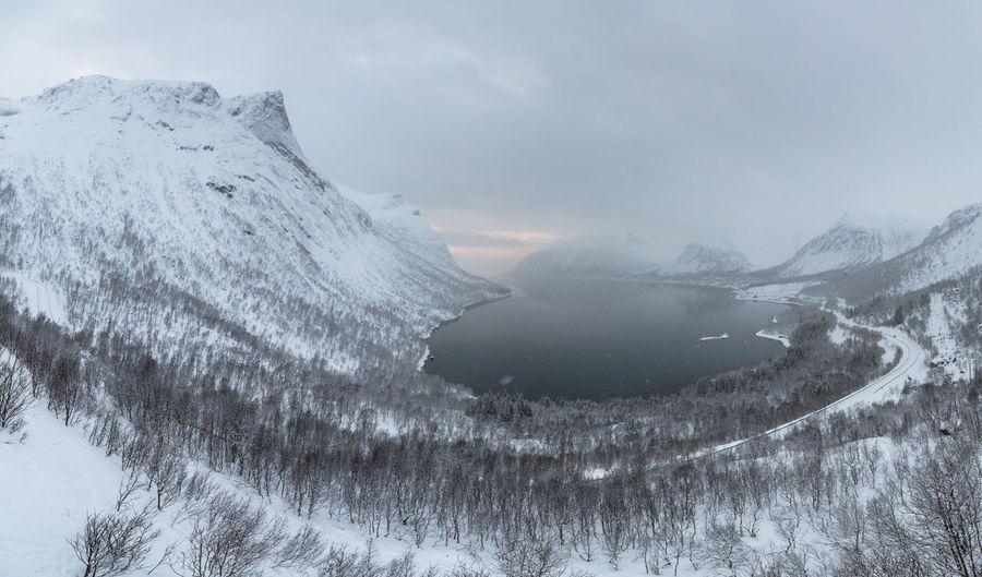 Bad Weather Cold Cold Temperature Deep Clouds Geology Hill Landscape Mountain Mountain Range Nature The Great Outdoors - 2016 EyeEm Awards Northern Norway Norway Perspective Physical Geography Power In Nature Remote Scenics Snow Snowing Sunset Landscapes With WhiteWall Tranquility Tree Winter