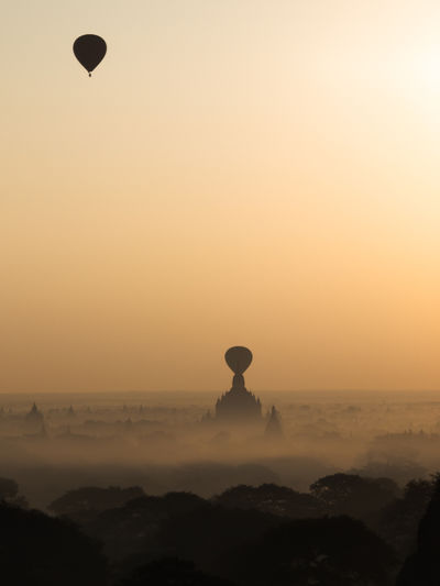 Silhouette Hot Air Balloons Flying Over Bagan Archaeological Zone At Sunrise