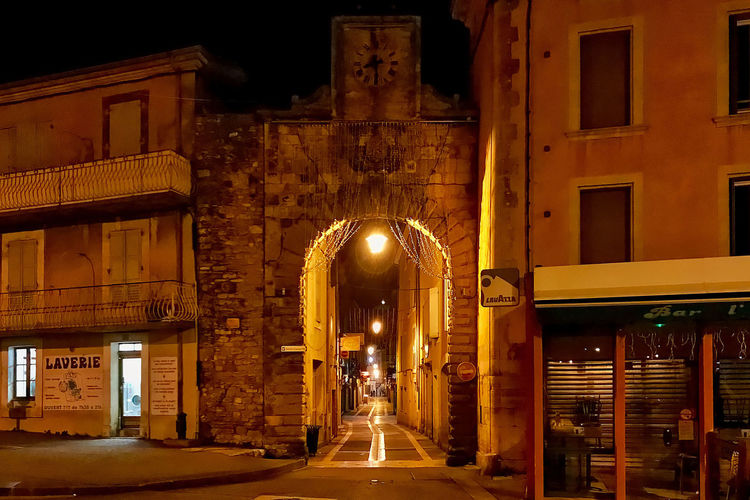 An entrance to the old city of Apt in France. Apt Architecture Building Exterior Built Structure Clock Entrance France Gate Illumination Night Old Town Outdoors