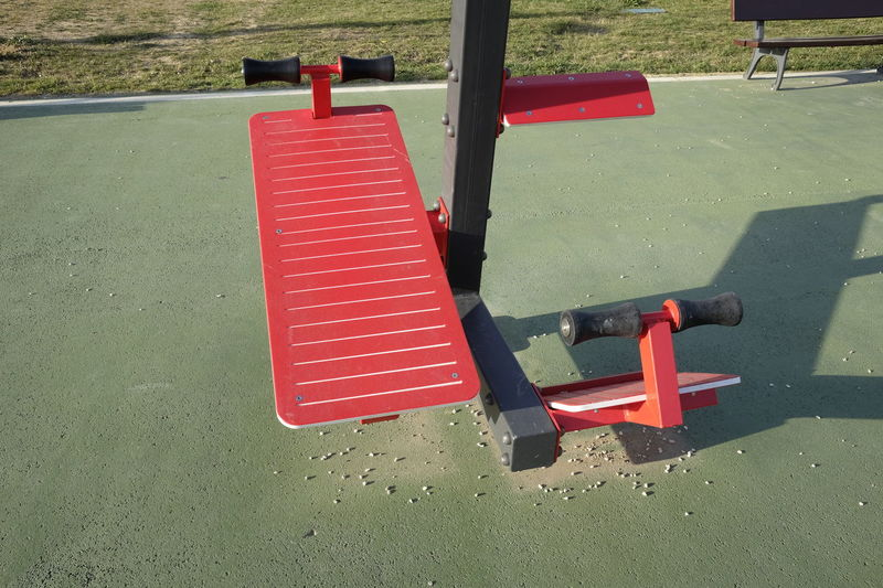 gym equipment in the park Bench Red Abdominal Equipment Excercise Time Fitness No People Outdoors Public
