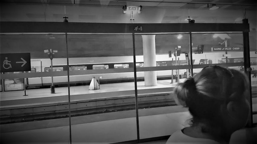 Marne la Vallee-Chessy for Disneyland Resort Paris 2017 2017 2017 Year 2017 Photo Black & White Marne La Vallee-Chessy Marne La Vallee-Chessy DLRP Black And White Black&white Blackandwhite Blackandwhite Photography Close-up Day Illuminated Indoors  One Person People Public Transportation Rail Transportation Real People Rear View Subway Station Train - Vehicle Transportation Window Women