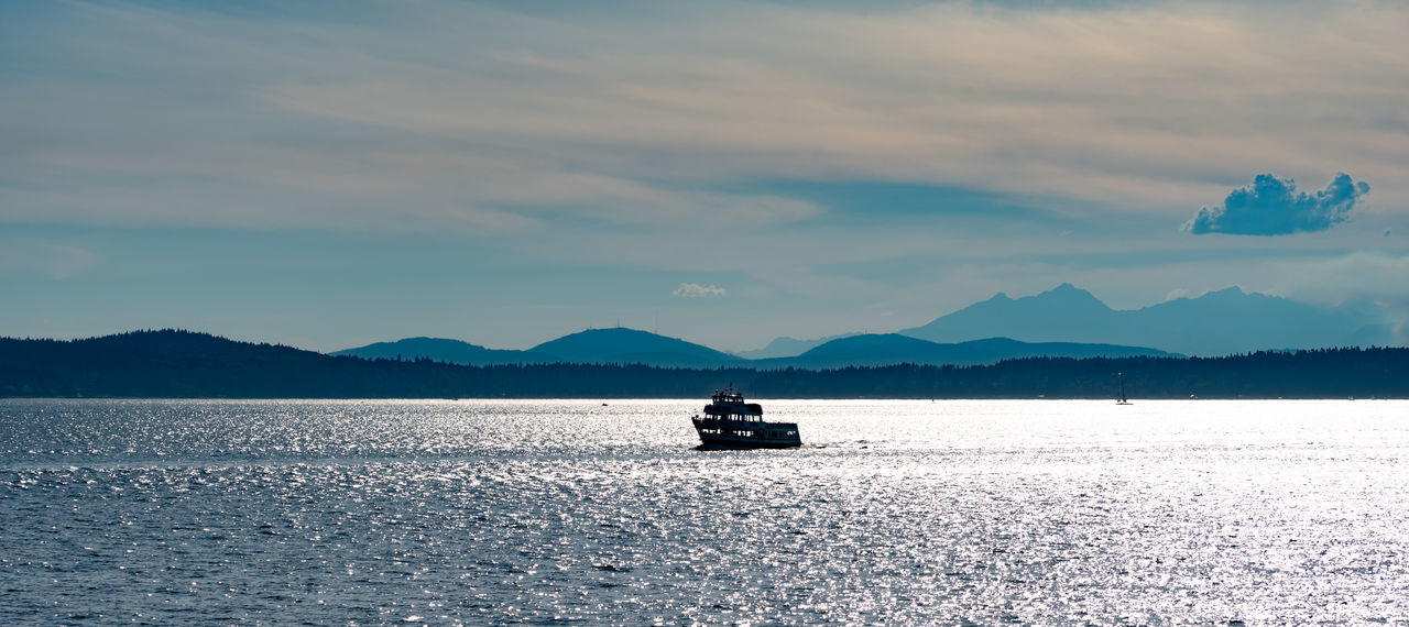 Beauty In Nature Cloud - Sky Day Mode Of Transportation Mountain Mountain Range Nature Nautical Vessel No People Outdoors Sailing Scenics - Nature Sea Sky Tranquil Scene Tranquility Transportation Travel Water Waterfront