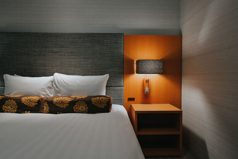 Illuminated electric lamp on bed at home