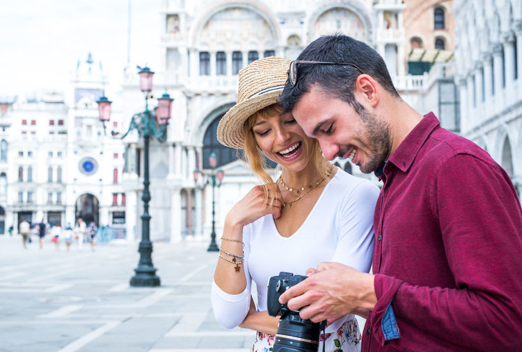 Portrait of a smiling couple in city