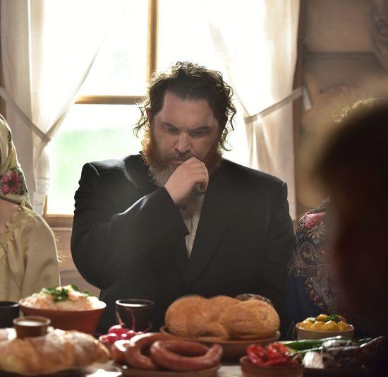 Man having food on table