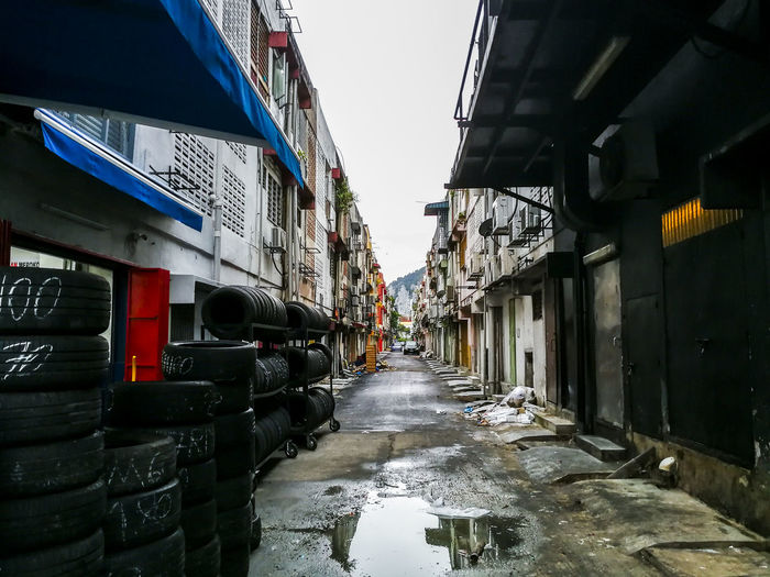 Architecture Back Alley Back Alleys Back Ally Backyard Building Exterior Built Structure Day Diminishing Perspective No People Outdoors Perspective Puddle Of Rain Puddle Of Water Reflection Sky Straight Ahead Up Ahead Water