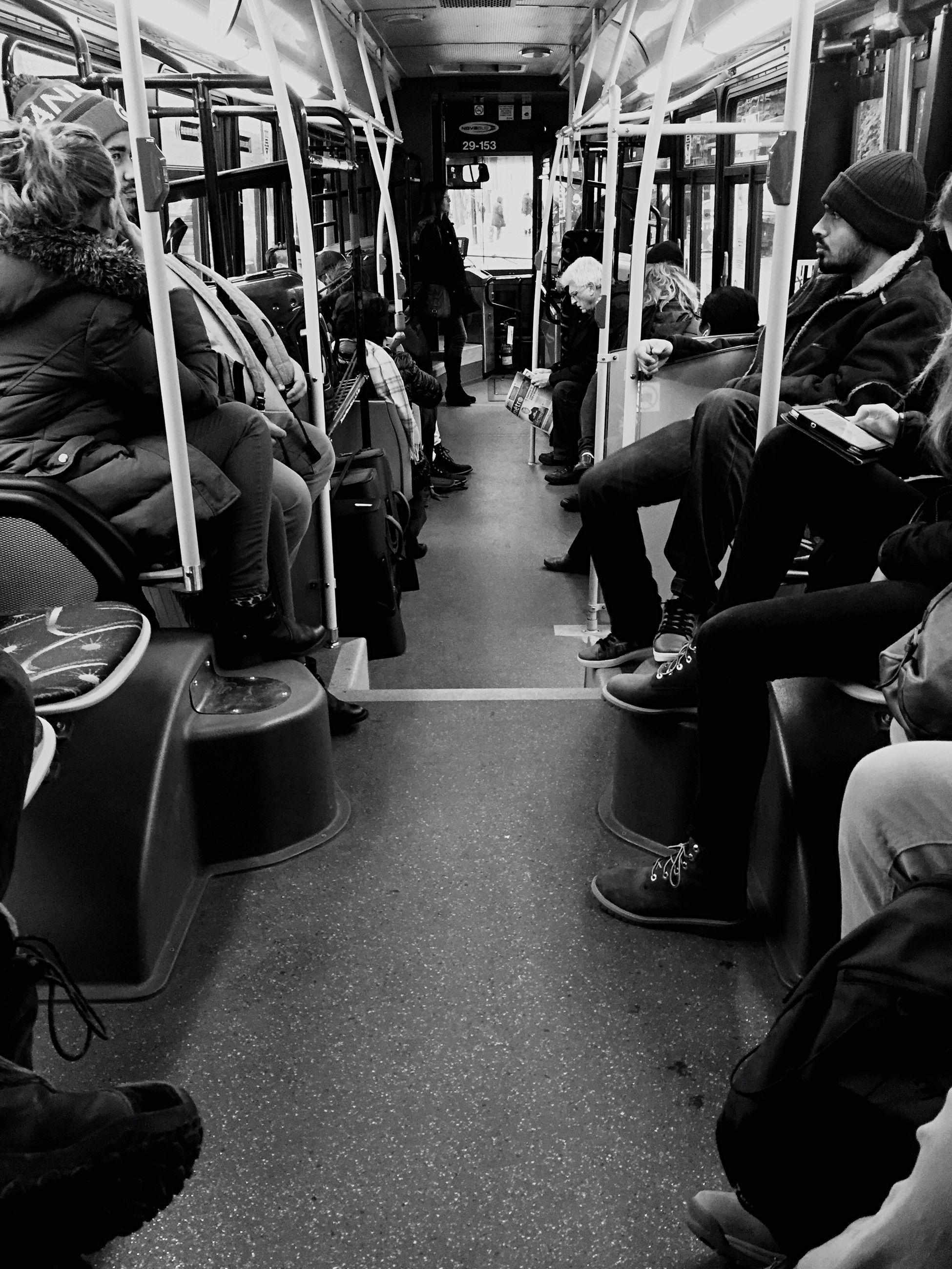 vehicle interior, train - vehicle, transportation, public transportation, subway train, mode of transport, sitting, passenger train, commuter train, vehicle seat, train interior, large group of people, real people, passenger, rail transportation, men, land vehicle, commuter, women, day, adult, people