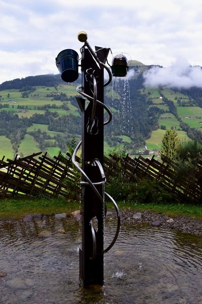 Water in motion! Buckets EyeEmNewHere Art Cloud - Sky Day Grass Nature No People Outdoors Sky Spraying Tree Water Water Display