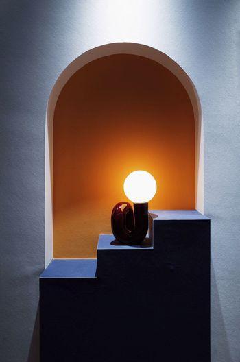 Close-up of illuminated lamp on wall