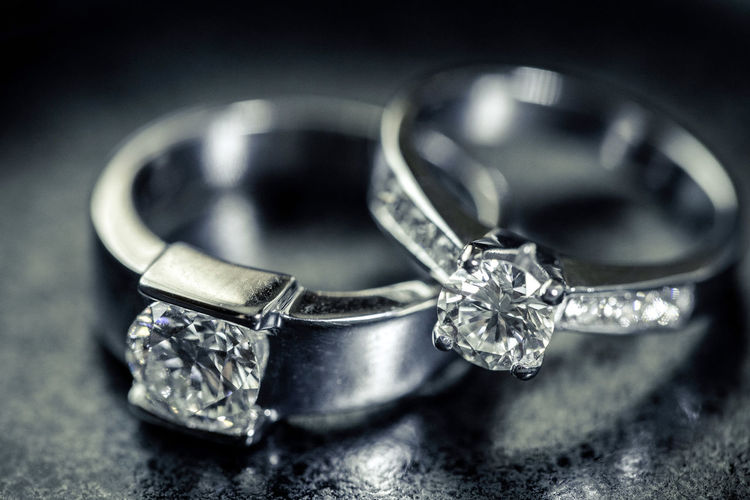 Wedding rings Close-up Diamond - Gemstone Diamond Ring Engagement Ring Indoors  Jewelry Love Luxury Metal No People Personal Accessory Platinum Precious Gem Ring Selective Focus Shiny Silver Colored Still Life Table Two Objects Wealth Wedding Ring Wedding Rings Wedding Rings Photography