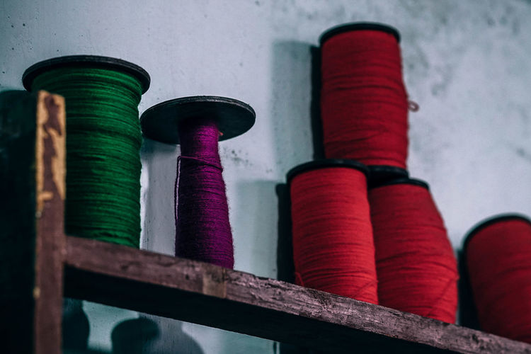 Purple Thread Fashion Green Industry Needlework Red Roll Background Closeup Cloth Clothing Color Cotton Craft Design Detail Embroidery Fabric Fiber Leisure Activity Material Needle Pattern Purple Reel Repair