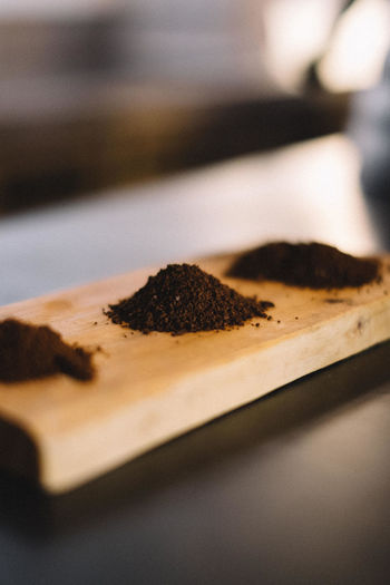 High Angle View Of Ground Coffee On Wood