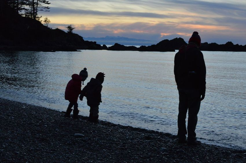 Watching the waves, two sons and their father. Kids Cool Winter Evening Sunset Sunset_collection Family PNW Anacortes Silhouette Full Length Togetherness Beach Outdoors Sky Water Nature