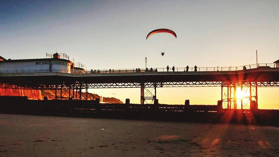 Sky Silhouette Outdoors Sea Bridge - Man Made Structure Architecture One Person Nature Day Parachute People Paraglider Sunset Sunset_collection