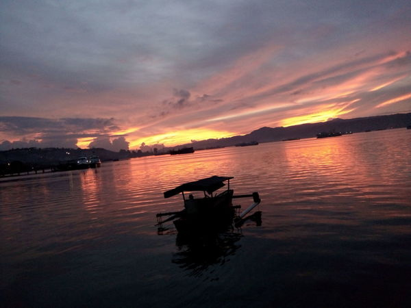 Sea Sealife Sunset INDONESIA Indonesia_photography Wooden Ship Wooden Ships Upon The Water Alamindonesia Alam_indonesia Kapalkayu Calm Happiness Sea Life Ship Perahu Ambon Woodenships Steel Ship Calmness Calm Waters Calm Sea Restorant On The Beach Restorant Behind