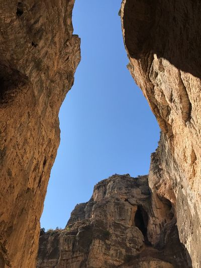 Rock Formation Low Angle View Geology Natural Arch No People Beauty In Nature Blue Architecture