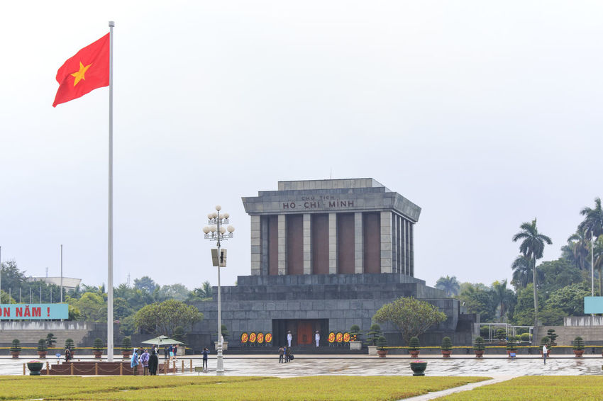 Hanoi, Vietnam: February 23, 2016: Ho Chi Min mausoleum in Hanoi city on a rainy day Architectural Column Architecture ASIA Built Structure City City Life Culture Day Grass Hanoi Vietnam  Ho Chi Minh Mausoleum Hoan Kiem Lake Landmark Low Angle View No People One Pillar Pagoda Outdoors People Pole Sky Tourists Traffic Traffic Jam Travel Destinations Vietnam