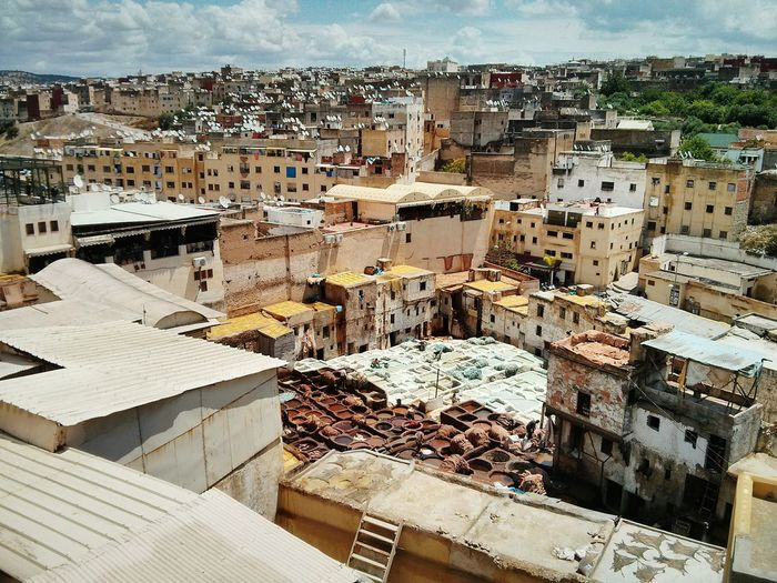 High angle view of tannery amidst buildings in town
