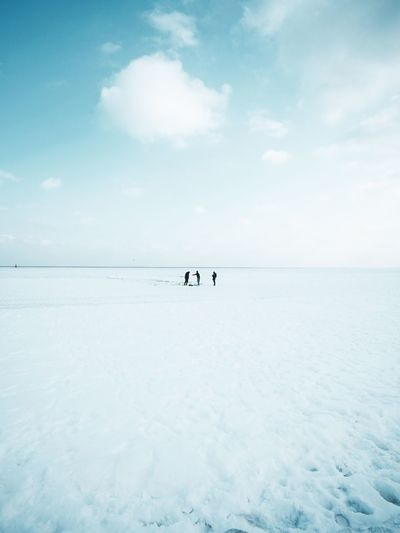 People standing on snow against sky