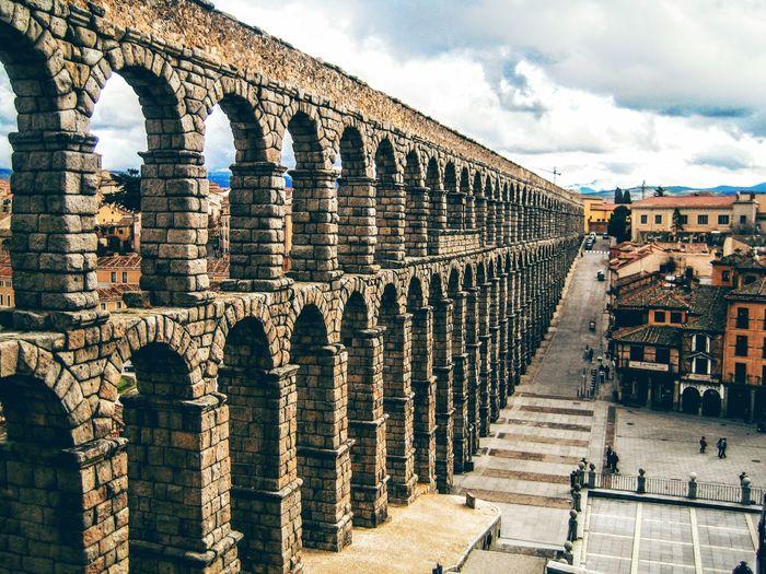 Aqueduct against cloudy sky