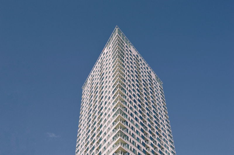 Architecture Built Structure Building Exterior Low Angle View Sky Building City Clear Sky Office Building Exterior Tall - High Modern Blue Skyscraper No People Nature Office Day Tower Outdoors Triangle Shape Architecture_collection Archilovers 17.62° My Best Photo