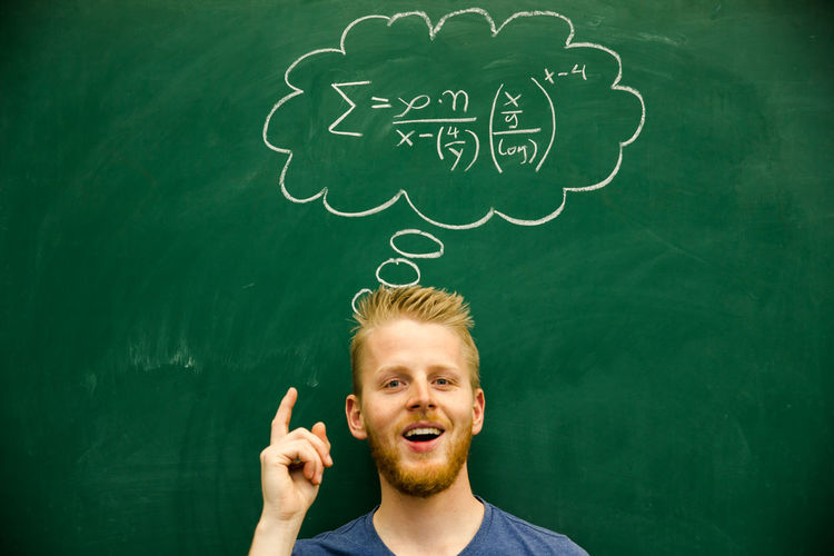 Man with mathematical formula on blackboard