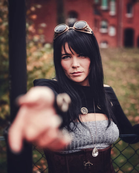 Portrait of a beautiful young woman in steampunk costume
