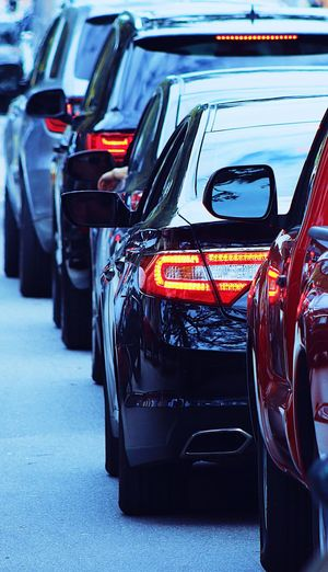 Rush hour traffic Car Mode Of Transportation Motor Vehicle Transportation Land Vehicle Stationary City Government Tail Light Night Parking Lot Road Outdoors Parking In A Row No People Headlight Red Traffic Street