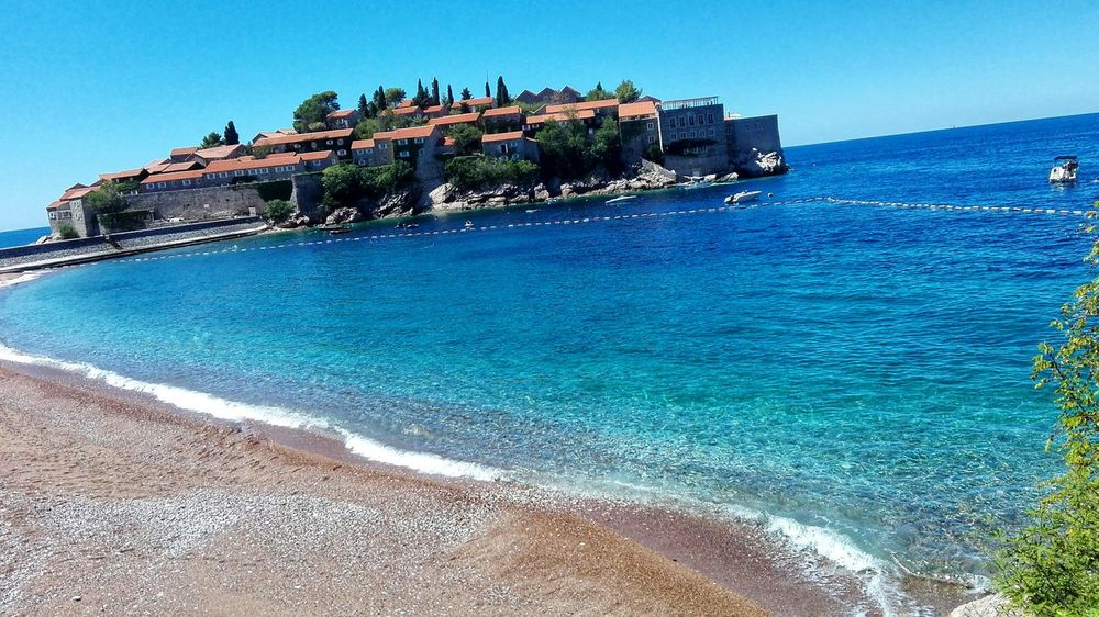 I miss it...❤🌅🌴 Holiday Sun Sunshine Summer Adria SvetiStefan Montenegro My Love Miss I Miss It  Sea Beach Water Rock - Object Outdoors Blue Day No People Sky Clear Sky Travel Destinations