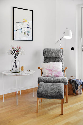 Armchair and ottoman by side table at home