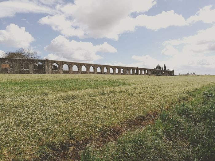 Aqueduto Aqueduct Évora  Field Agriculture Agricultural Land Agriculture Rural Scene History Sky Architecture Grass Cloud - Sky Built Structure Old Ruin Ancient Civilization Ancient Cultivated Land